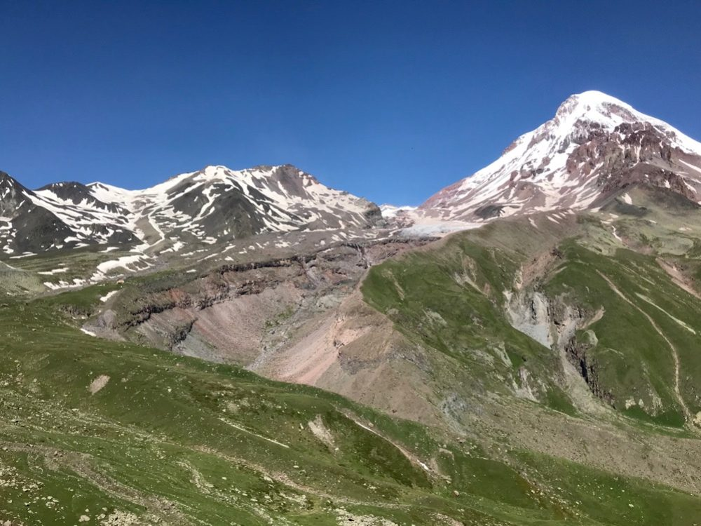 Kazbek is a popular climb and there are 2 huts (3000m and 3600m) for climbers to stay at. The easiest route goes around the Gergeti glacier to the Russian side of the mountain and up