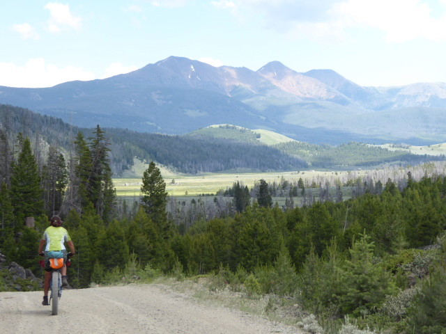 At the top of our second big climb of the day – this one was rideable – we camped in the open meadows